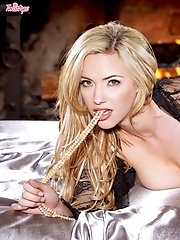 Sophia Knight spends a horny evening by the fireplace