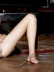 Kiera Winters masturbates beside the piano
